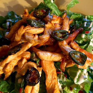 Buff strip Salad with Chipotle Ranch Dressing.