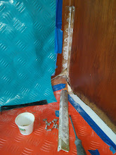 """Photo: """"L"""" between port cabinet & bulkhead removed.  Minor corrosion found on aluminum bracket.  Suprized Morgan used 3/4"""" wood screws.  Plan to reinstall with 1"""" to 1-1/4"""" screws."""