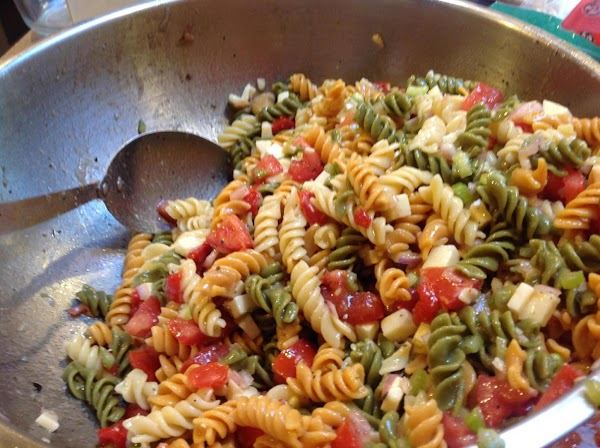 Add in the cooked pasta and seasoning, stir till bended together, then chill a...
