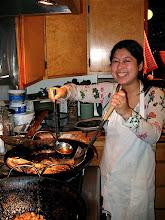 Photo: Lillian frying fish