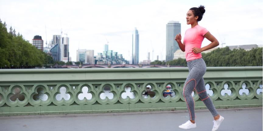 young-woman-jogging-across-Westminster-Bridge