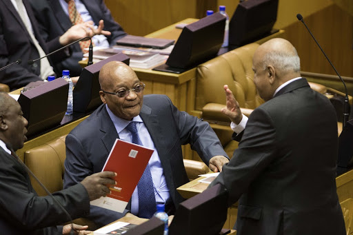 Pravin Gordhan, right, Jacob Zuma, centre, and Cyril Ramaphosa have a conversation in Parliament in this file photo. Picture: TREVOR SAMSON