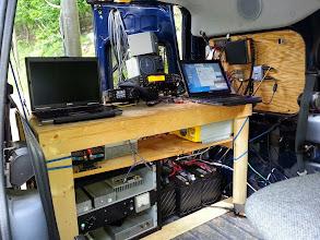 Photo: Operating shelf (L->R) Jacobs Box, 222 Transverter & Inverter. Floor (L-R) Microwave Transverters, 3 12V marine batteries