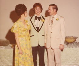 Photo: David with parents Ava and Roger Powell.