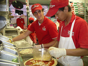 Photo: Guess what two toppings Suman is putting on this pizza he is making.......  ok---I will tell you:    Large lump crab, and corn! We sold this crap pie only in 2010 but discontinued it due to lack of sales.  If I do not sell at least 25 of any type of pizza or topping a day, it comes off the menu. It`s just how it has to be so that everything is used up constantly as so to have absolute fresh food constantly.  You do not want to go into any resturant and order something they do not sell a ton of, because that would mean its been sitting in the refrigerator!!!--No No NO!! When I go to a resturant, I always say what does this resturant sell the most of---what dish.....  That way I know, the food will be as fresh as possible!  We at Pino`s have been accused of having a limited menu...but trust me, a limited menu is a good thing.  It mean we only sell what sells like crazy, which means it was just fresh made that day.   Everything on the menu at Pinos has been fresh made 2-3 times a day!!