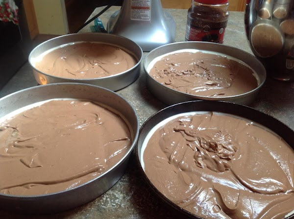 Spray four 8 or 9 inch cake pans with bakers joy, and distribute cake...
