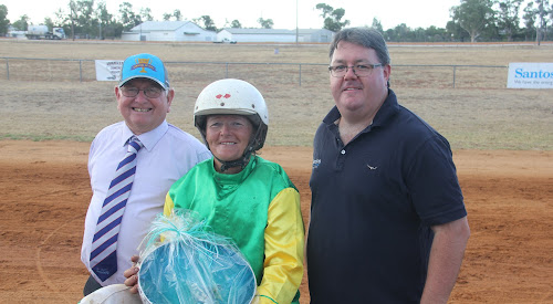 Santos Cup Carnival of Cups winning trainer and driver Lola Weidemann, flanked by Narrabri Harness Racing Club president Peter Shepherdson and Santos' Bill Wood.