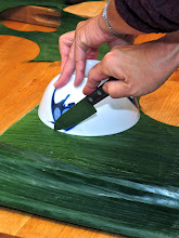 Photo: cutting a banana leaf round with a 6-inch bowl as a guide