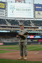 Photo: Before throwing out the first pitch at Target Field on Sept. 1, 2015, Maj. John Donovan addresses the pregame crowd on behalf of Minnesota Recovery Connection. Minnesota Recovery Connection annually invites members of the recovery community to a gathering at Target Field to celebrate their recovery from addiction and raise awareness of National Recovery Month. Minnesota National Guard photo by Army Staff Sgt. Patrick Loch/ Released