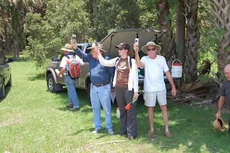 Photo: Everyone looking for a good GPS signal. Dunbar in dark blue shirt at the Helen Blazes site, Brevard County, Florida.