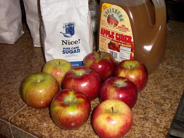 Pour the apple cider and sugar into a large pot or dutch oven and...