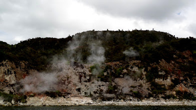 Photo: On a cruise of lake Rotomahana our group saw steaming cliffs, eruption sites, craters, and geysers.  The lake became twenty times bigger after the eruption.