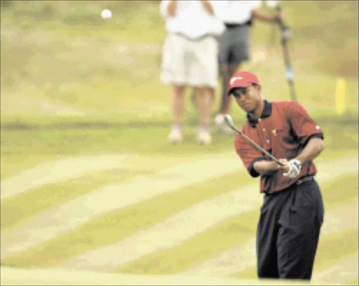 Presidents cup player Tiger Woods, at Fancourt's the links in George. 23/11/2003 pic by sydney seshibedi