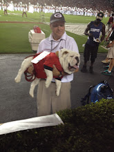 Photo: Uga being held by its trainer.