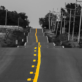 Follow by Christian Skilbeck - City,  Street & Park  Street Scenes ( hills, selective color, black and white, street, telegraph poles, undulating road, road )