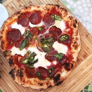 Pizza With Hot Soppressata, Mozzarella, Chilies, and Honey