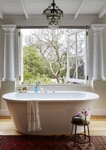 The balcony was converted into an open-plan bath area with a leafy outlook.