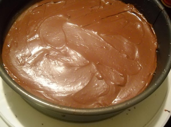 For Chocolate Cheesecake layer:1- In a double boiler, melt chocolate chips. 2- Cream remaining...