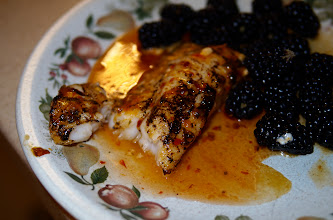 Photo: Flame seared cod fish with basil and Thai peppers, and chili sauce sauce. Blackberries on the side.