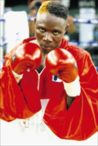 CONTENDERS: Willie Mabasa and Marcel Japhta, inset, will clash for the Gauteng provincial featherweight title tomorrow. 28/05/04. Pic. Lee Warren. © Gallo Images.