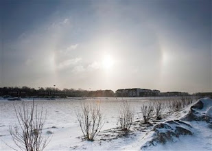 Photo: A sundog, or solar halo, appears in the sky above snowy Omaha, Neb., Wednesday, Jan. 14, 2009. Residents face a midday temperature of 3 degrees Fahrenheit and a wind chill of -20 as the Midwest faced an arctic cold wave. (AP Photo/Nati Harnik)