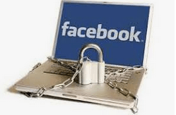a laptop with a chain and padlock displaying the facebook logo on the screen