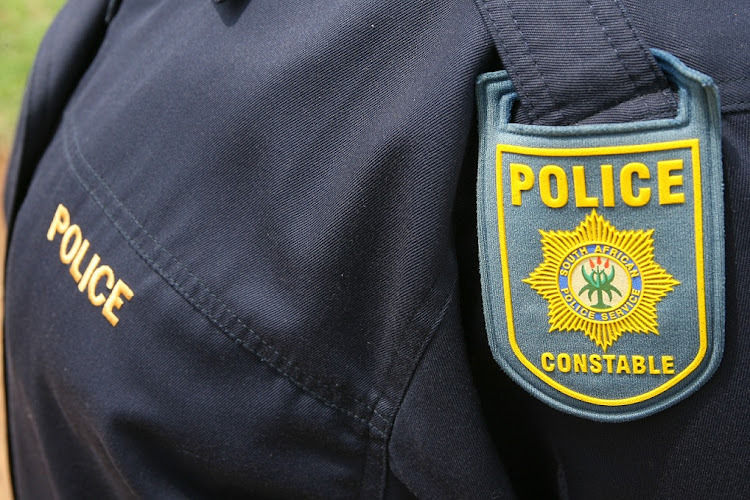 File photo. A KwaZulu-Natal police officer has killed his wife and her brother in a divorce court before turning the gun on himself.