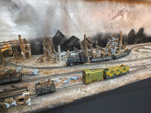 Photo: 115 A Baldwin 4-6-0T passes the row of ruined houses with a short supply train .