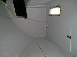 Photo: tabbing along bulkhead and engine compartment wall in quaterberth completed and painted
