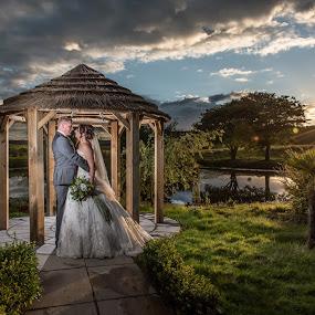 Hold Me Closer.... by Nigel Hepplewhite - Wedding Bride & Groom ( love, flash, ocf, sky, pagoda, sunset, wedding, landscape, bride, groom )