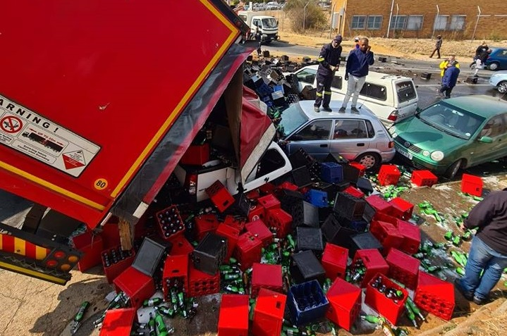 Looters helped themselves to beer after a SA Breweries truck crashed into three cars, spilling the truck's contents into a main road in Krugersdorp.