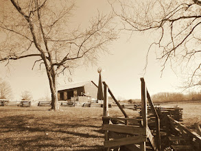 Photo: Sepia photo of a barn and windmill on a farm at Carriage Hill Metropark in Dayton, Ohio.