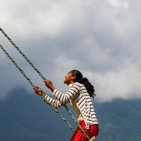 Airtime by Chris Wangard - People Street & Candids ( swing, woman, himalayas, nepal )