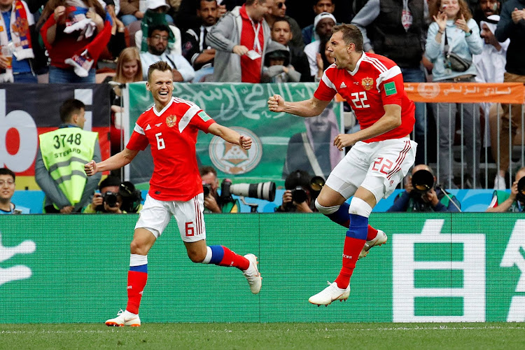 Russia's Artem Dzyuba celebrates scoring their third goal with Denis Cheryshev.