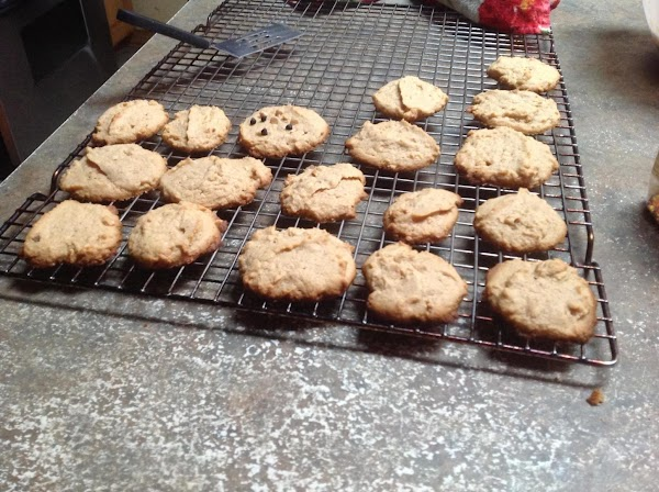 Remove cookies from sheet pan and place on cooling rack to cool completely,then transfer...