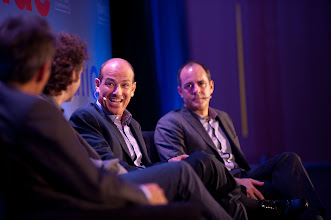 """Photo: Howard Gordon (center) reacts during the """"Hollywood and Policy"""" panel discussion Friday, Nov. 16 at the RAND Politics Aside event in Santa Monica as fellow panelist David Nevins looks on."""