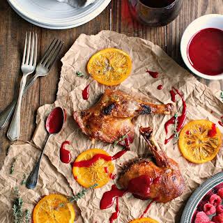 Crispy Duck with Candied Orange Raspberry Sauce.