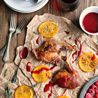 Crispy Duck with Candied Orange Raspberry Sauce.