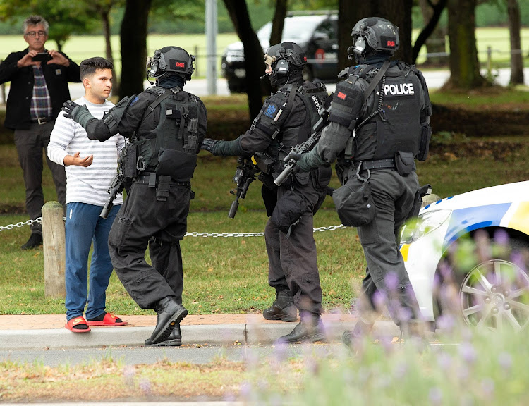 AOS (Armed Offenders Squad) push back members of the public following a shooting at the Masjid Al Noor mosque in Christchurch, New Zealand,, March 15, 2019.