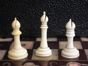 Photo: Comparison of pieces in three Cantonese ivory travel sets  Bishops  some of the king's size differences are lost on this piece.  It's interesting that the two right hand pieces have the top knop sliced through, as on some Jaques pieces. I wonder if this can be used to class/date these sets?