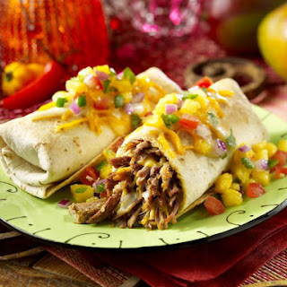 Baked Chimichangas with Spicy Pork Filling and Tropical Salsa.