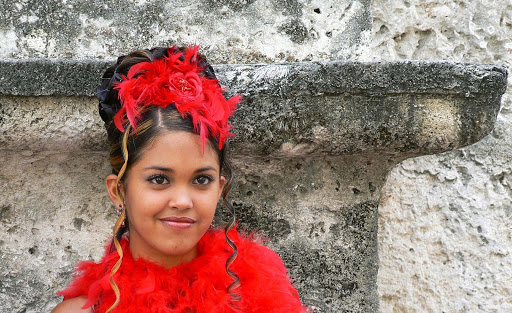 A girl dresses up for a festival in Cuba.