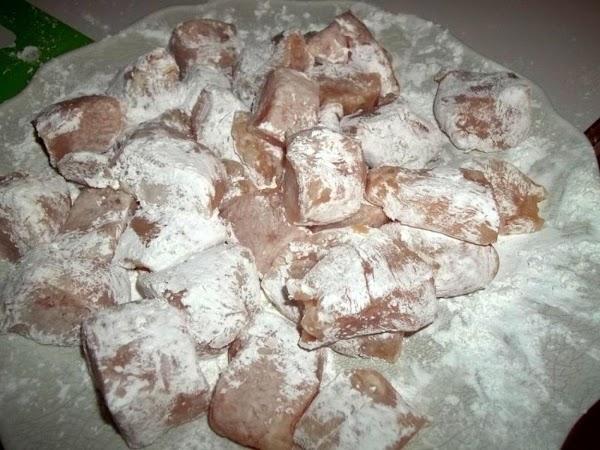 Coat chicken with cornstarch or potato starch. (I used corn starch)