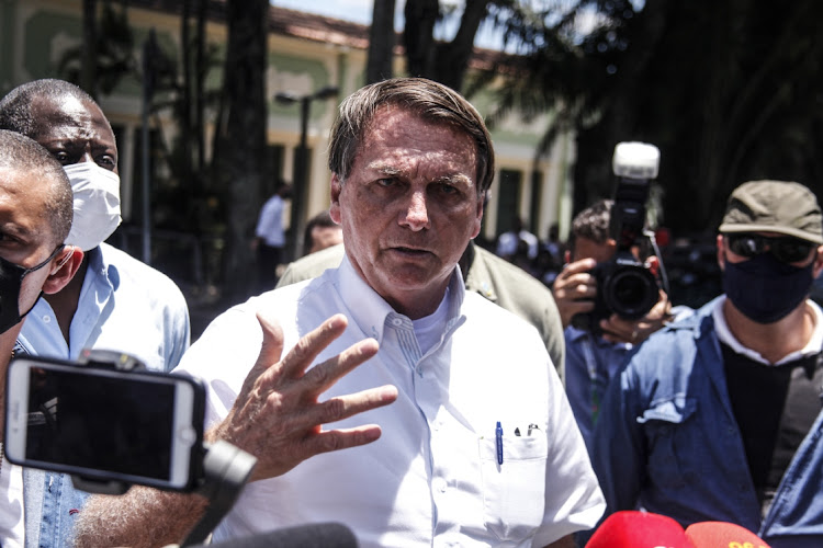 President Jair Bolsonaro talks to the press after voting during the municipal elections at Vila Militar in Rio de Janeiro, Brazil, November 29 2020. Picture: LUIS ALVAREGA/GETTY IMAGES