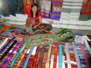 Photo: Laos is known for their hand loom weavers. A great variety of cotton and silk shawls are available.  Most of them cost $5-10!
