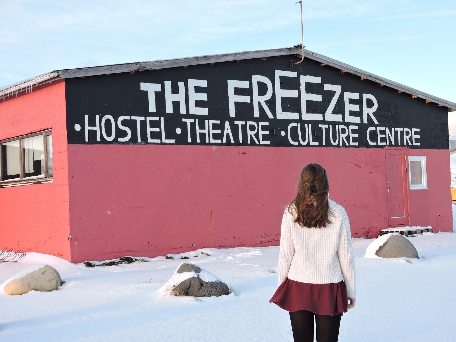 A women standing in front of a hostel in Snæfellsnes peninsula.