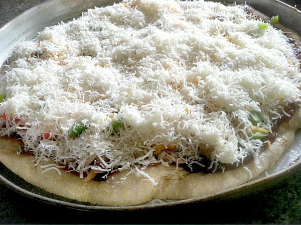 Now add the remainder of your cheeses over your pizza, smile at your creation...