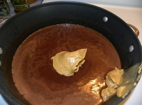 Add peanut butter and vanilla; stir until peanut butter is melted into chocolate.