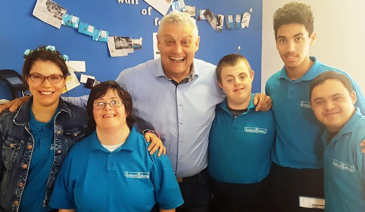 Comedian Barry Hilton with staff at Brownies & Downies.