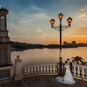 Love under the sunset by Emest Freezo - Wedding Bride & Groom ( prewedding, sunset, weddings, wedding, couple, scenery, landscape, bride, groom, photography )